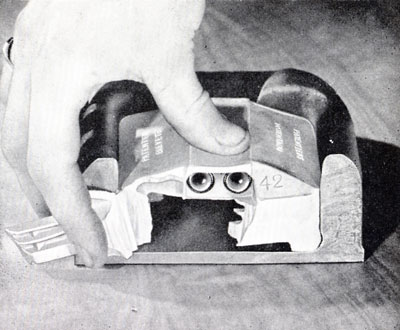Black and white photo showing a cut away of a Catseye, with one set of wipers pulled away to show the flexible housing