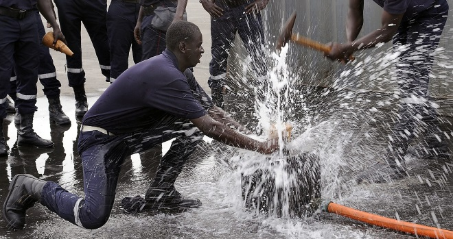 Firemen fixing a leak