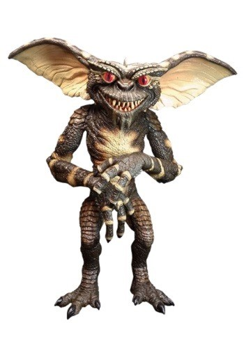 Picture of a standing gremlin. He is dark and scaly. His eyes are glowering at the viewer menacingly