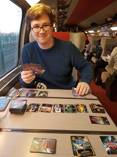 I am on a train playing a card game